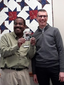 Eric Staton receiving award from CADL's Executive Director.png