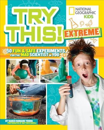 Boy on the cover of science magazine Try This holding a beaker
