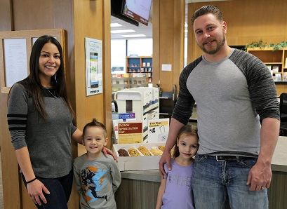 Family posing in library.