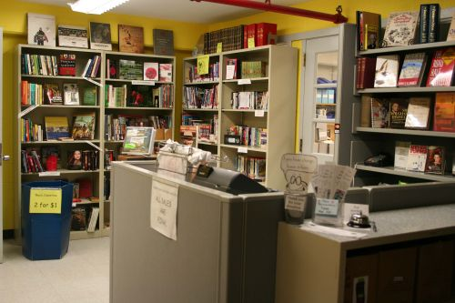 A view of the sales desk and several shelves of the Book Burrow used book store.