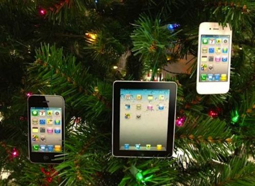 ipad and iphone hanging on christmas tree